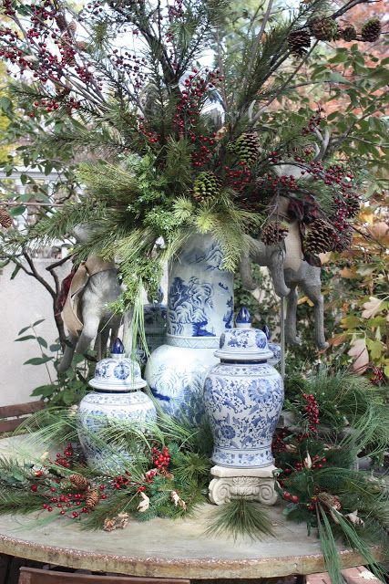 via Lee's Hideaway This vignette takes decorating for the holidays with Chinoiserie to another level entirely and it's gorgeous. A collection of blue and white Chinese porcelain with Christmas greens,