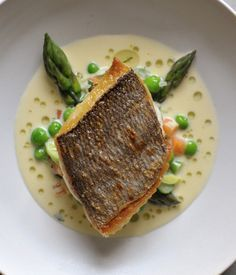 The firm flesh of bream is here complimented by the sweet flavour of cream-enriched tartare-style sauce flecked with potatoes, asparagus, lettuce and peas in Nathan Outlaw's recipe.