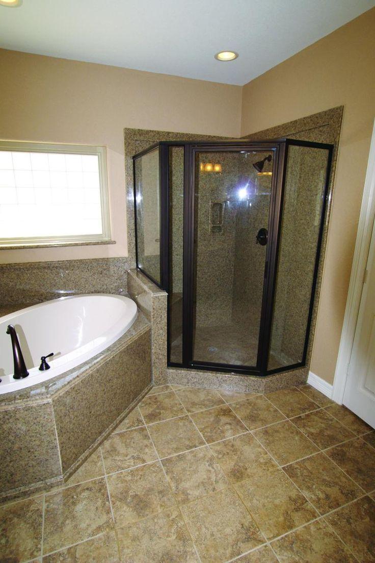 corner granite shower | Above: made-to-order cultured granite bathtub surrounds and shower.