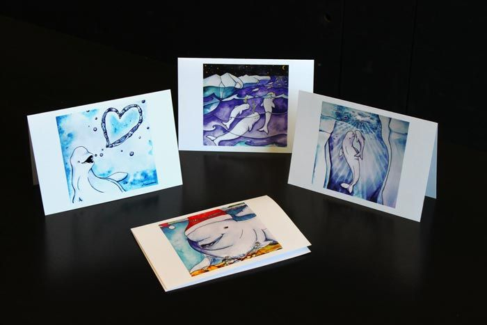 Beluga greeting cards (pack of 12)  This card pack celebrates beluga whales. The four designs in this pack are: 1) a beluga blowing a heart bubble, 2) belugas migrating under a starry sky, 3) an adult and baby beluga surfacing in icy waters and 4) a beluga in a Santa hat! Message on back: This card helps protect Canada's forests, fields, mountains, rivers, lakes and oceans and all the creatures that call them home — including belugas.