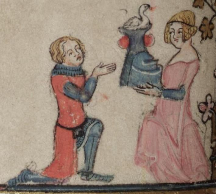 A knight in red receiving a helmet from a damsel in pink, from an English manuscript of The Romance of Alexander (1338-1344).