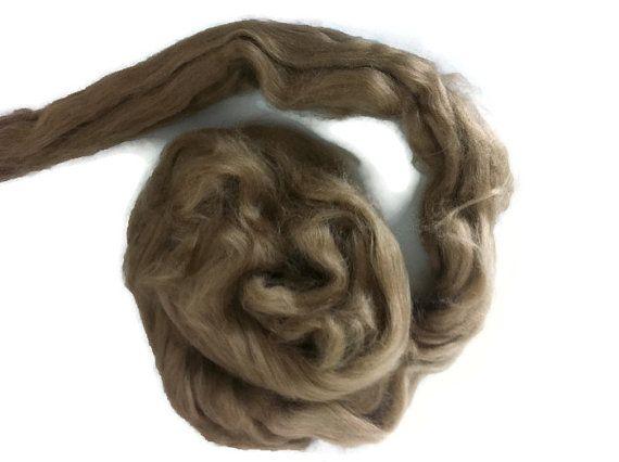 1 oz Tussah silk roving , color Earth.