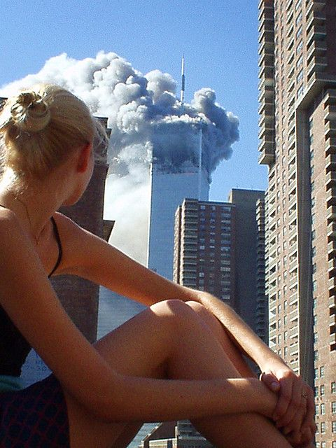 Australian model caught distracted during a photo shoot when the first plane hit tower 1. What an epic photo.
