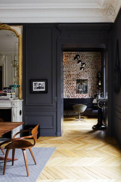 Dark colour to decorative plaster walls, parquetry flooring,