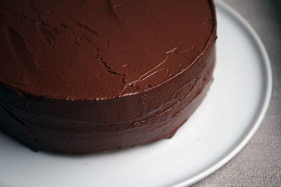Grown-Up Birthday Cake - made with white wine and olive oil, this yellow cake is moist and delicately flavoured; a coat of bittersweet chocolate buttercream pulls everything together