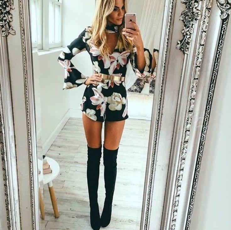 Floral romper, gold belt, black thigh high boots
