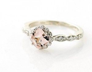 How cute and dainty, with mini diamonds to outline the ring.