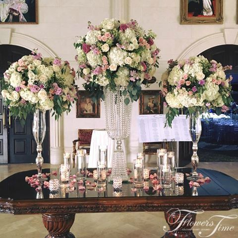 Wedding Reception crystal centerpieces ivory and pink-coloured blooms, purple roses #event#toronto#glass#style#bride#inspiration#ideas