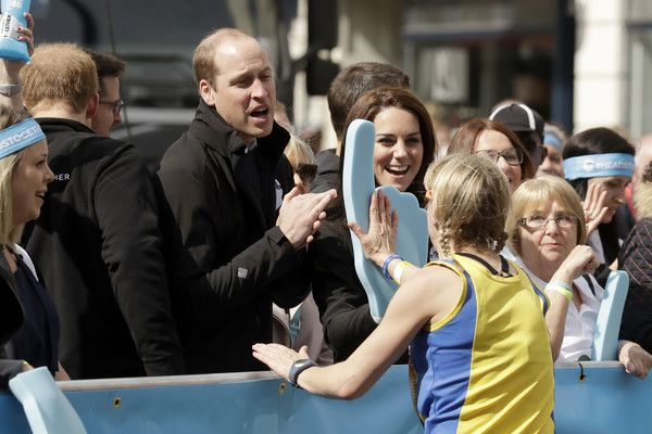 Prince William, Duke of Cambridge and Catherine, Duchess of Cambridge cheer on runners at a 'Heads Together' cheering point along the route of The Virgin Money London Marathon 2017 on April 23, 2017 in London, England.