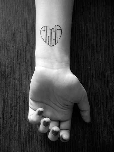 Simple and cute way to tattoo your kids' names.