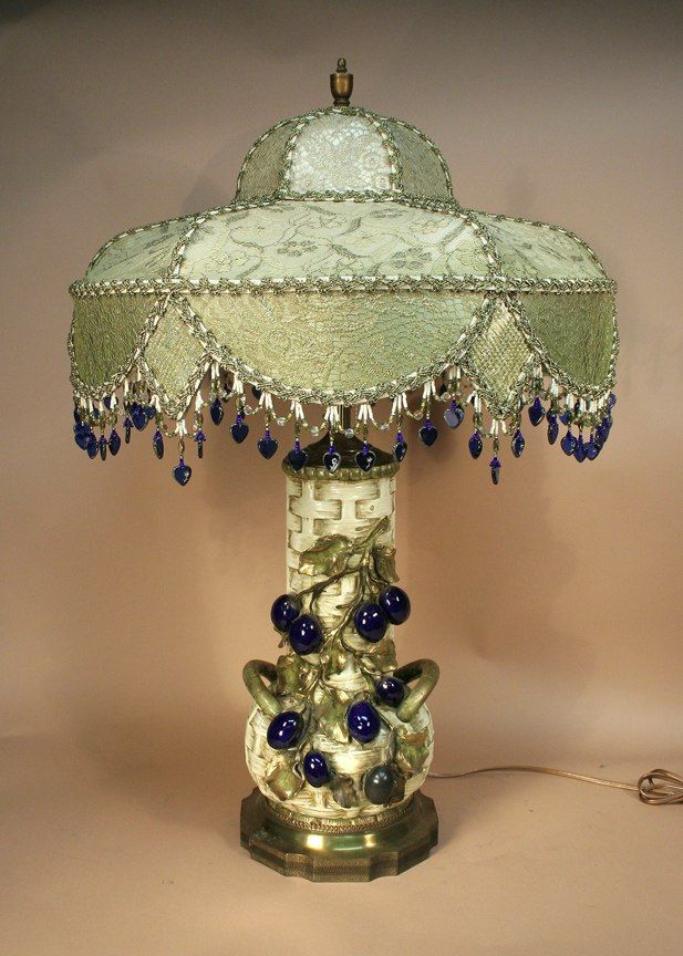Vintage cream and olive toned lamp covered with metallic lace and hung with looped cobalt blue beaded fringe