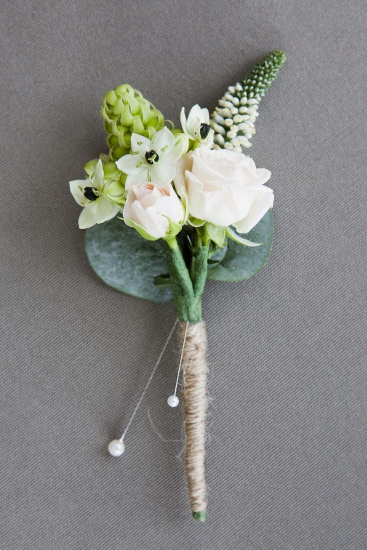 Buttonhole of pink spray roses Veronica White Chins and eucalyptus and mini succulent