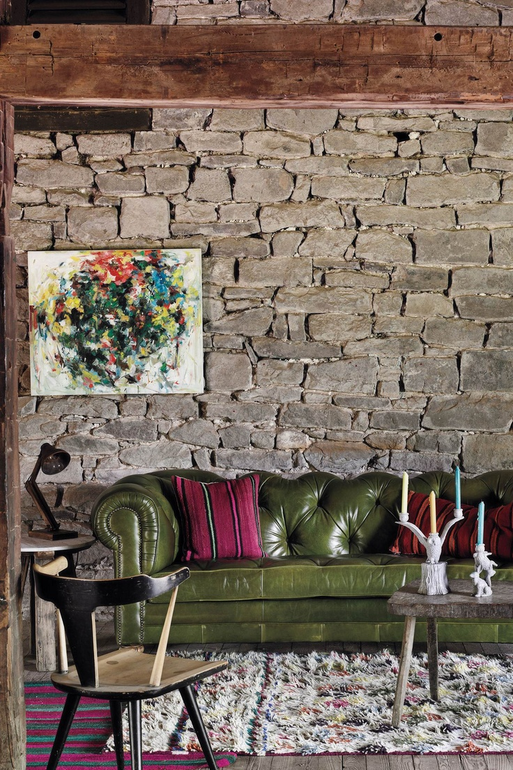 Anthropologie Home Decor Green Sofa And Stone Walls