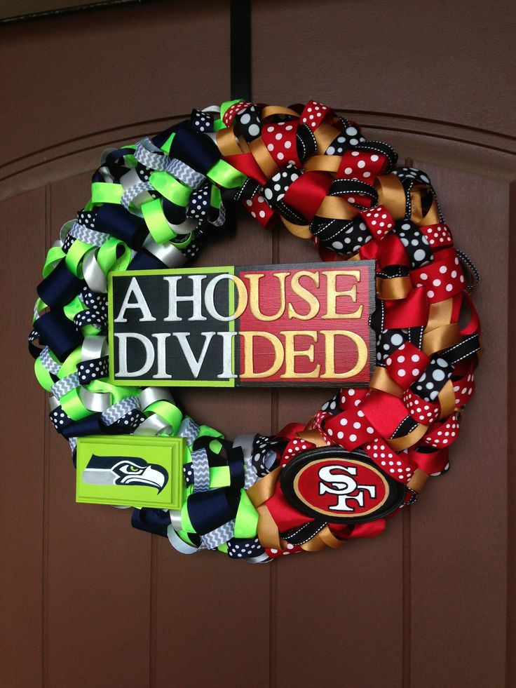 "Seahawks/49ers ""House Divided"" ribbon wreath. All hand painted signs. Facebook.com/loveliladesigns"