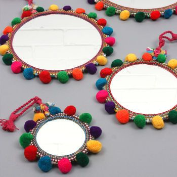 Boho Pom Pom Mirror to bring a pop of color to your kids bedroom decor #kidsroom #mirrorsforkids #mirrordesign Find more inspirations at www.circu.net