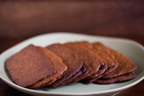 Ultra-thin gingersnap cookies with molasses and ground ginger, baked ...