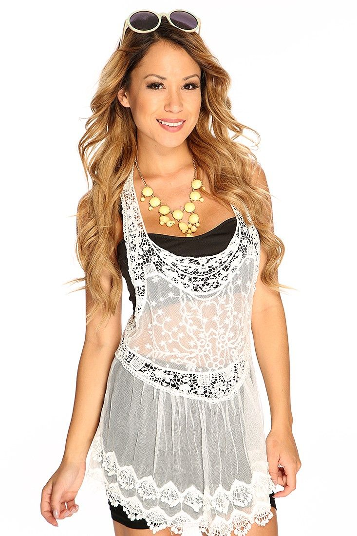Cute summer crochet top includes; floral crochet mesh detail, scoop neck, sleeveless, racer back, scallop trim, and fitted. 100% Polyester.