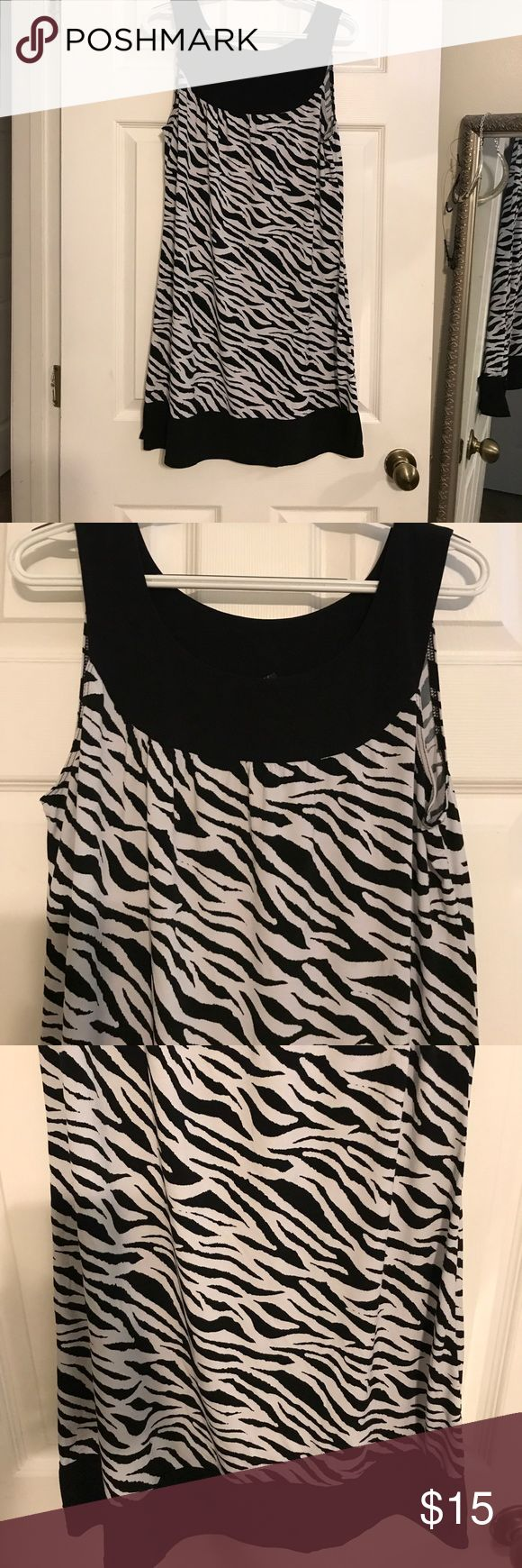 Adorable black and white zebra print dress This adorable black and white zebra print dress is sleeveless very soft and silky size extra-large good used condition wrapper Dresses Midi
