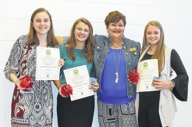 Karen Callaway, Gardner Newman Middle School teacher, stands with winners of the Optimist Club girls oratorical contest, from left, Libby Criswell, first place; Bethany Forbus, second place; and Sarah Beth Batchelor, third place.  Contributed | Troup County schools