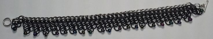A+beautiful+chainmail+bracelet+using+a+Persian+weave+with+beads.+Approximately+10+inches+long.+Available+in+black,+Stainless+Steel+or+green.