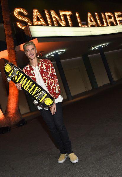 dfebd11c Justin Bieber Photos - Recording artist Justin Bieber, in Saint Laurent by  Hedi Slimane, attends Saint Laurent at the Palladium on February 10, ...