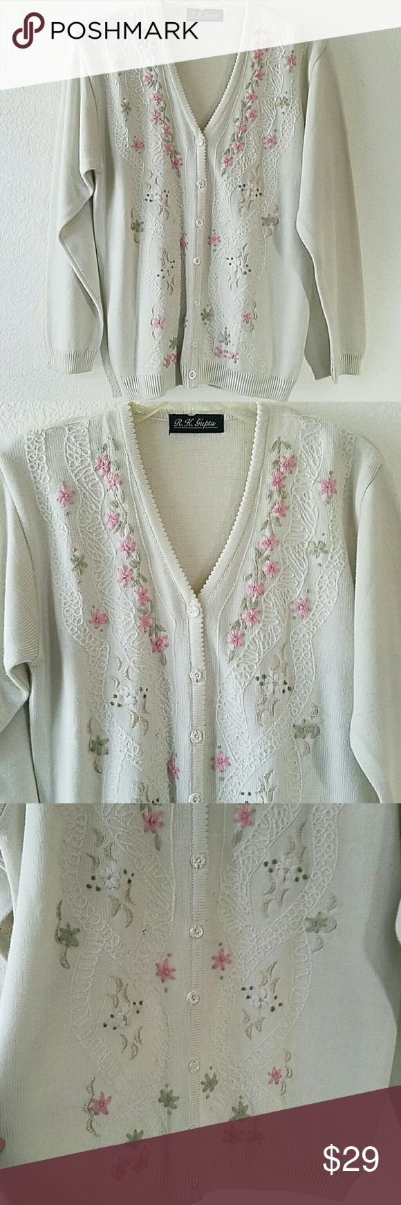 """Floral Front Button Cardigan Beautiful like new floral button front cardigan. Used only once. No stains or damages. Approx L of cardigan 26"""". Armpit to armpit approx without stretching 19 1/2"""". Shoulder to shoulder hem 17"""". Ivory color. Sweaters"""