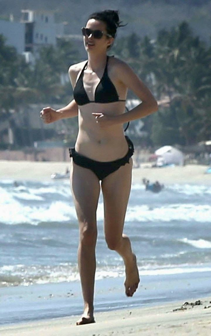 The Veronica Mars actress, Krysten Ritter spotted looking slender in a blue dark bikini as she was sure to drilled her athletic side along the boarding with a female friend during her vacation at Cabo San Lucas, Mexico on Tuesday, April 29, 2014. (See more 40 PHOTOS and 2 videos).