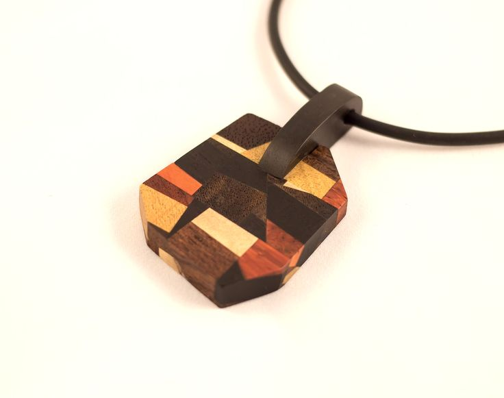 Pendant of a mixture of exotic woods.