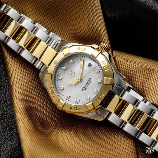 A strong woman needs a watch to match. Shine bright this summer with the TAG Heuer Aquaracer Lady Gold. #AquaracerLady #Diamond #Gold #KelleyJewelers #DowntownWeatherfordOK