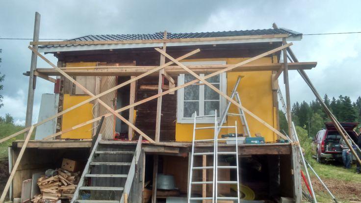 cabin outside renovation old deck teardown
