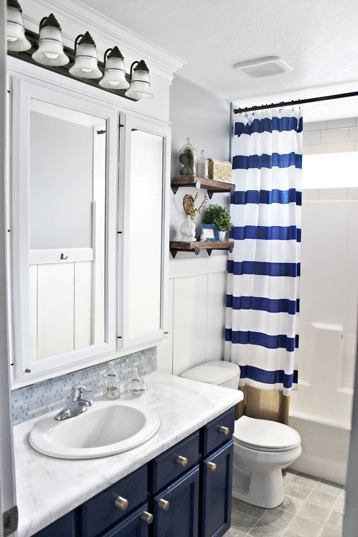 Clever trim work extra storage and fresh paint transform a basic bathroom into a