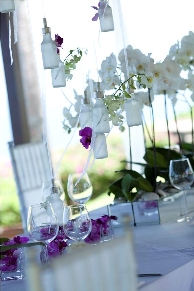 Bottles with dangling Orchid by Tirtha Bridal Uluwatu Bali