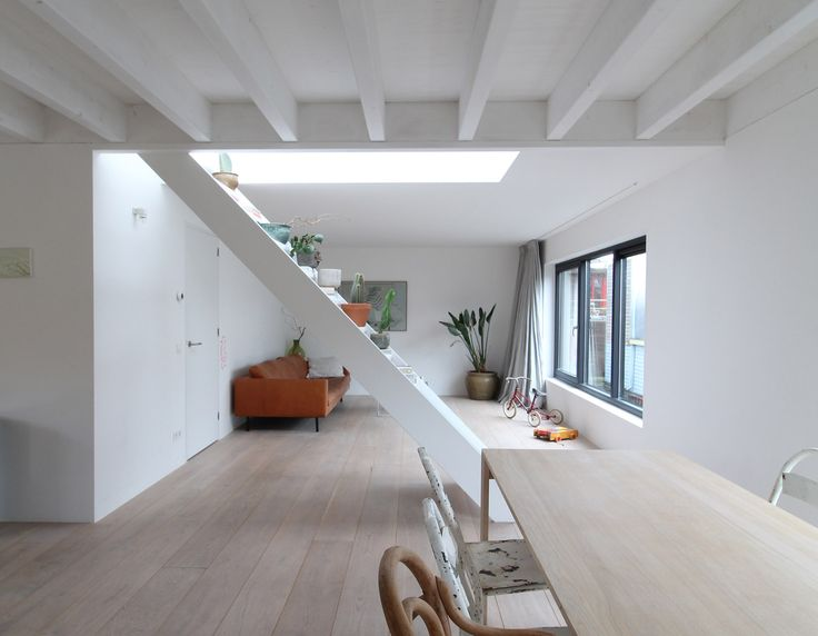Architect Julius Taminiau borrowed principles from traditional Japanese tatami rooms to create a well-proportioned layout featuring space-saving built-in furniture at his floating home in Amsterdam.