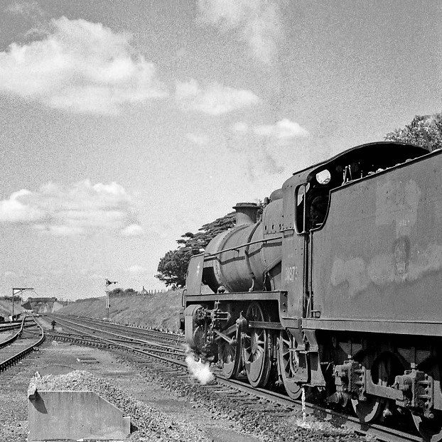 An old Maunsell Mogul leaves New Milton with a down local from Eastleigh. This particular locomotive was withdrawn and scrapped so after the picture was taken.  Hampshire, England. Negative scan.