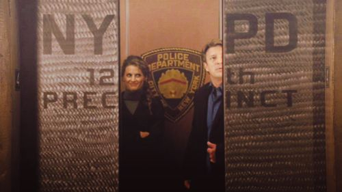 NYPD- 12th precinct elevator (look at her face...adorkable!)
