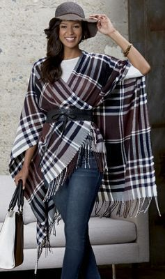 As cozy as a favorite blanket, this belted, fringed poncho wraps you in warmth while instantly whittling your waist.