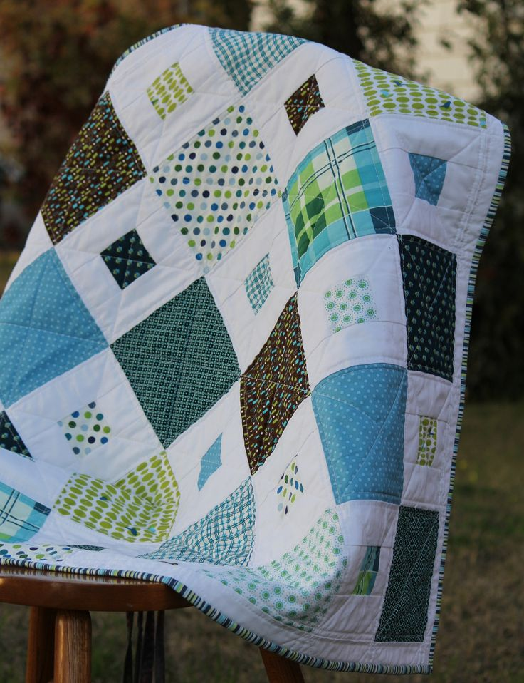 Square In Square – Modern Baby Quilt measures 34 inches by 34 inches. (after washing) This fresh looking handmade quilt is a simple little quilt with a wonderful pop of zesty color. Showcasing a bright modern palette of Blue, Lime, and Brown mixed in with some white, it would be ideal for either a boy …