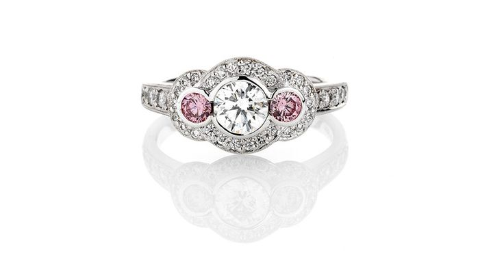 Rare Argyle pink diamonds in Art Deco style ring with pave set white diamonds
