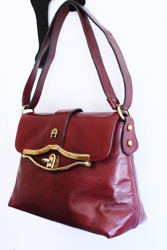 Etienne Aigner Vintage 1970's Leather Purse Oxblood Calf Skin Huge Fold Over Goldtone Hardware Adjustable Shoulder Strap. $44.50, via Etsy.