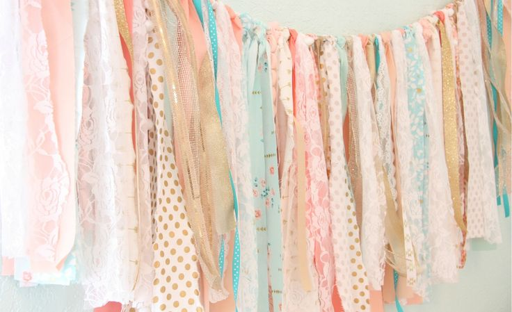 Katy Mimari from Caden Lane is sharing the simple steps she took to make an adorable DIY fabric garland for a sweet coral and gold girls nursery.