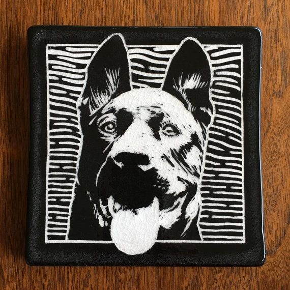Handmade Tile. Porcelain clay with black slip and clear glaze.  This 6inx6inx.5in tile is a hand-carved portrait of Sarge, a German shepherd mix currently available for adoption at the Seattle Humane Society. Check out their website for more information on this handsome fellow. This tile can be installed in a field of commercial tiles, hung on a wall (hardware available upon request), or used as a trivet. It's the perfect gift for your favorite pet lover. For every shelter dog tile sold, $5…