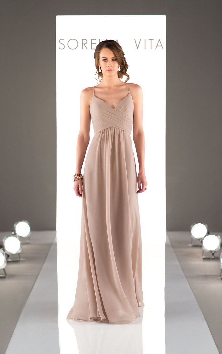 A criss-cross bodice of this bridesmaid gown flows perfectly into a floor-length chiffon skirt. Featuring a v-neck and spaghetti straps, it is the perfect combination of romantic and elegant.