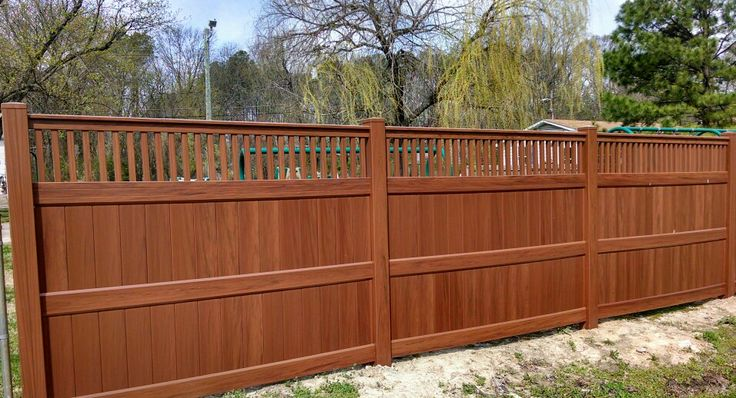 Evershore vinyl fence is a elegant verigated wood grain ...