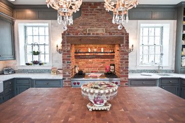 Brick from the 18th century in New Jersey. This brick surround was part of this 18th-century home's original kitchen. Intent on saving it, the design team fit a 48-inch Wolf range inside and custom designed a hood to fit into the still-functional chimney.