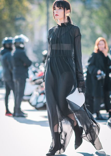 Street Style Guide To Wearing Black This Summer—Sheer long sleeve maxi dress