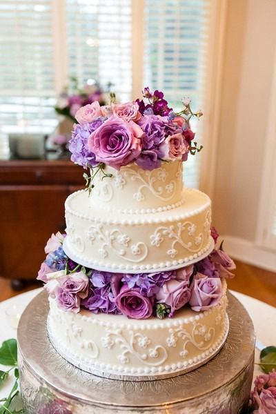 Spring wedding cake idea - three-tier wedding cake with purple + pink floral layers and elegant frosting details {The Collection} #purpleweddingcakes