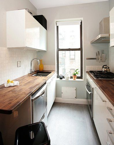 Narrow kitchen. Love the counters and eggshell blue walls :