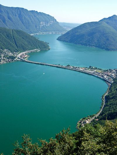 Lake Lugano, Switzerland. Lake Lugano is a glacial lake which is situated on the border between south-east Switzerland and Italy. The lake, named after the city of Lugano, is situated between Lake Como and Lago Maggiore. I went water skiing here