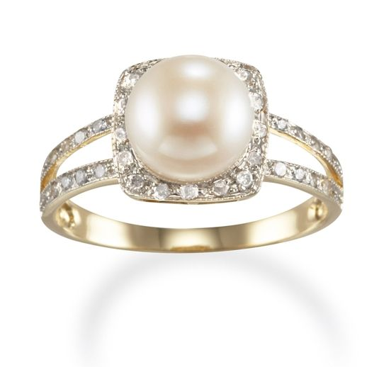pearl engagement ring - this was my idea first lol but mine will look much more bomb.com ;)