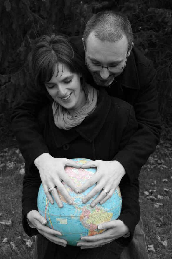 Use a globe for a sweet adoption pose. | 38 Insanely Adorable Ideas For Your Maternity Photo Shoot